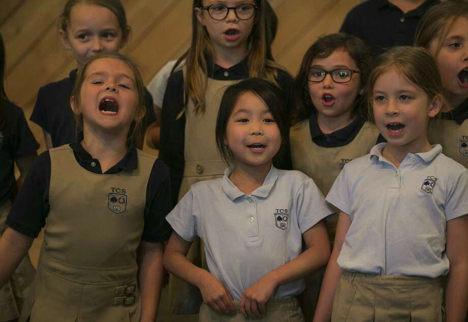Mrs. McCalip's kindergarten class recites poetry during lunch time at Trinity's Bethel campus. The school is a school-based homeschooling program that mixes two days of at-school instruction with at-home curriculum. Photo: Mark Mulligan, Houston Chronicle / Houston Chronicle / © 2018 Houston Chronicle