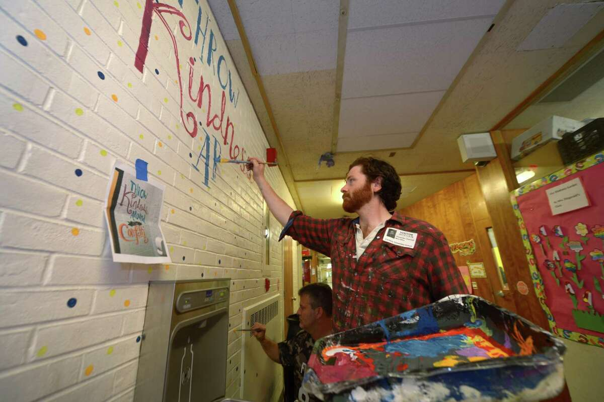 Alex Churchill from Floe Painting to paint inspirational sayings at Cranbury Elementary School Friday, June 1, 2018, in Norwalk, Conn.