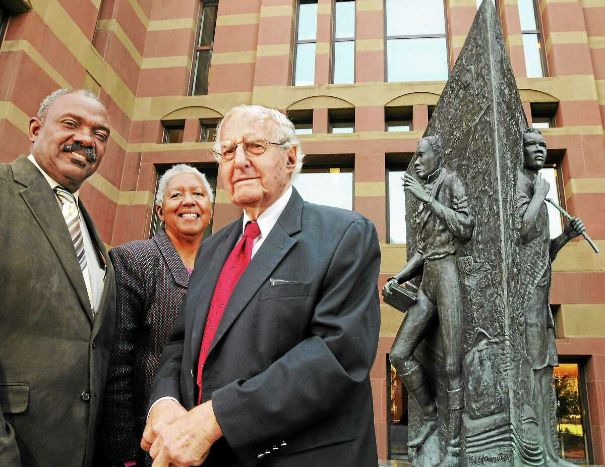 In this file photo. it was the 25th anniversary of the Amistad Committee, that has kept alive the spirit of the Amistad. Three members, left to right: Clinton Robinson, Roslyn Hamilton and Al Mardernext to the Amistad memorial outside New Haven City Hall.