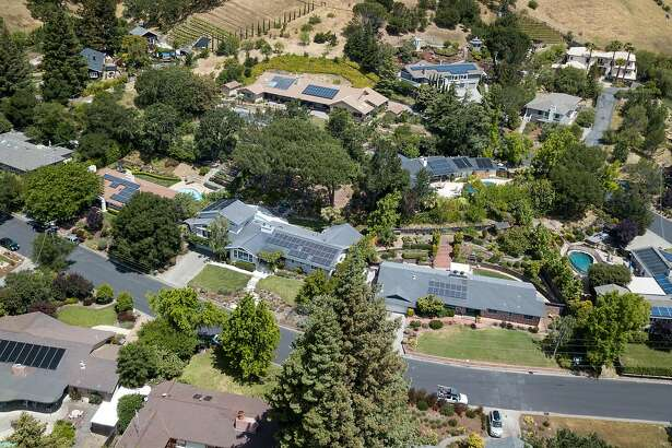Solar panels are seen on houses in San Anselmo, California on May 31, 2018.
