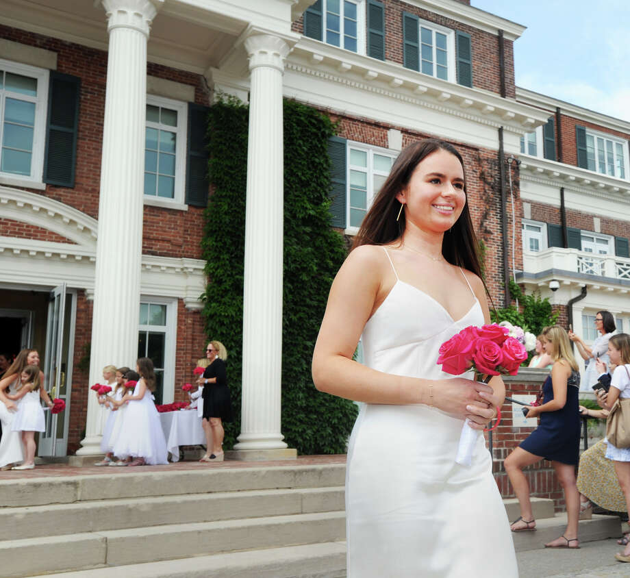 Annabell Knollmeyer of Bedford, N.Y., smiles as she holds a bouquet of red roses during her Sacred Heart Greenwich commencement at the school in Greenwich, Conn., Friday, June 1, 2018. Photo: Bob Luckey Jr., Hearst Connecticut Media / Greenwich Time