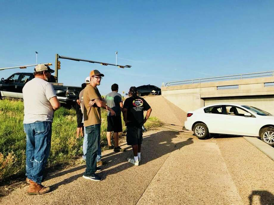 One San Angelo family was saved Friday from teetering off an overpass thanks to seven Good Samaritans. The Samaritans were identified as Reid Myers, Jacob Rodriguez, Paul Guevarra Pattrick Davidson, Adrian Martinez, Julio Vasquez and Marco Vasquez. Photo: Facebook/San Angelo Police Department