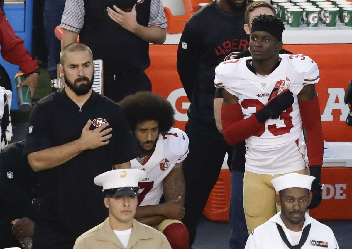 August 2016 - In the preseason, Kaepernick begins kneeling during national anthem to call attention to racial injustice in the US, particularly in reference to police brutality. This begins a series of similar protests at all levels of play, across sports, across the country. Here, Kaepernick, middle, kneels in September before the team's preseason game against the San Diego Chargers, in San Diego.