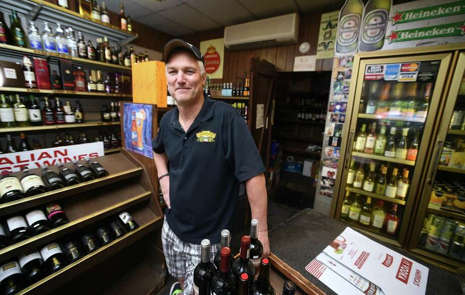 Orange Street Liquor Shop co-owner Gary Robinson in his store in New Haven. Photo: Arnold Gold / Hearst Connecticut Media / New Haven Register