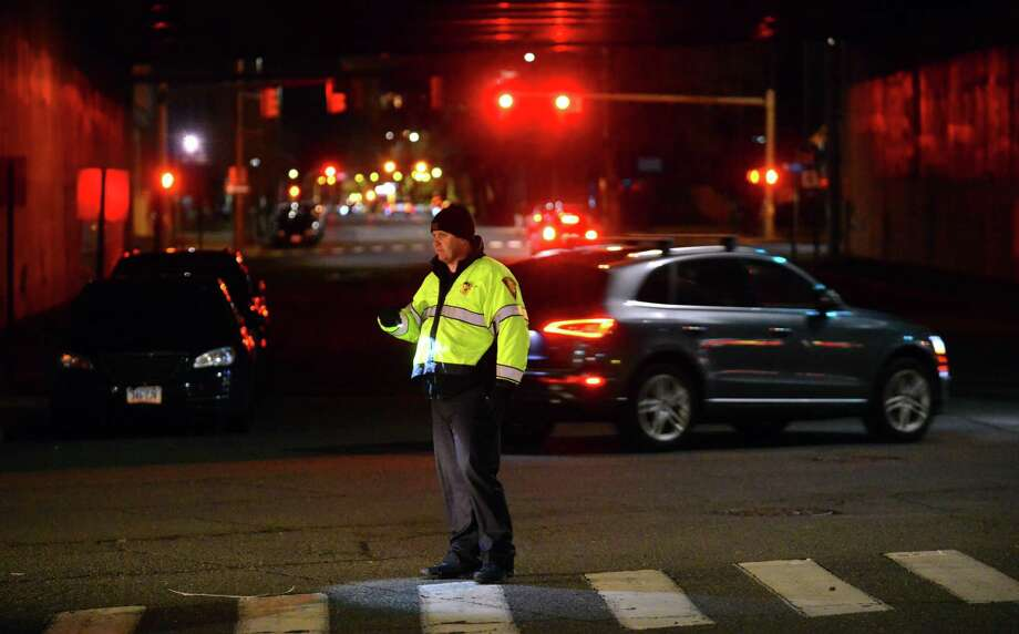 A Bridgeport Police Officer directs traffic for a Sound Tigers hockey game at the Webster Bank Arena in Bridgeport in January 2017. Photo: Christian Abraham / Hearst Connecticut Media / Connecticut Post