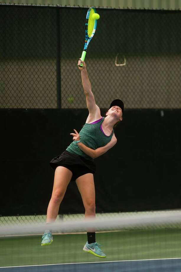 Dow senior Sarah Ismail serves the ball during a #3 singles match in the Division 1 state tennis tournament on Friday at the Greater Midland Tennis Center. (Katy Kildee/kkildee@mdn.net)