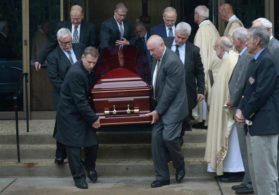 Pallbearers carry the casket as friends, family and coworkers attend the funeral for former three-term Norwalk Mayor, Frank N. Zullo, Friday, June 1, 2018, at St. Philip Church in Norwalk, Conn. Photo: Erik Trautmann / Hearst Connecticut Media / Norwalk Hour