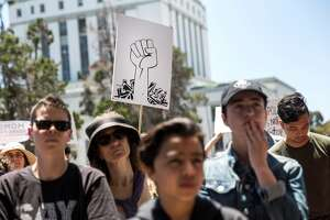 Protesters against the Trump administration's policies of separating immigrant children from their parents at the border rally�outside the Alameda County Sheriff's Office�on Friday, June 1, 2018 in Oakland Calif.