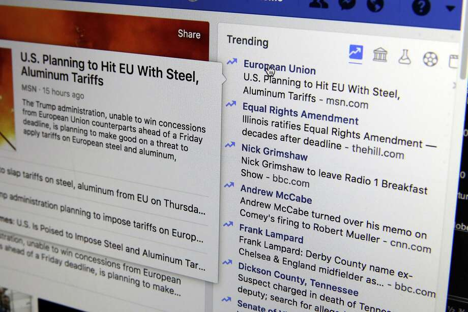 """FILE-- This Thursday, May 31, 2018, photo shows the Trending section on a Facebook account in New York.   Facebook is shutting down its ill-fated """"trending"""" news section after four years, a company executive told The Associated Press. The company claims the tool is outdated and wasn't popular. But the trending section also proved problematic in ways that would presage Facebook's later problems with fake news, political balance and the limitations of artificial intelligence in managing the messy human world. Photo: Richard Drew, Associated Press"""