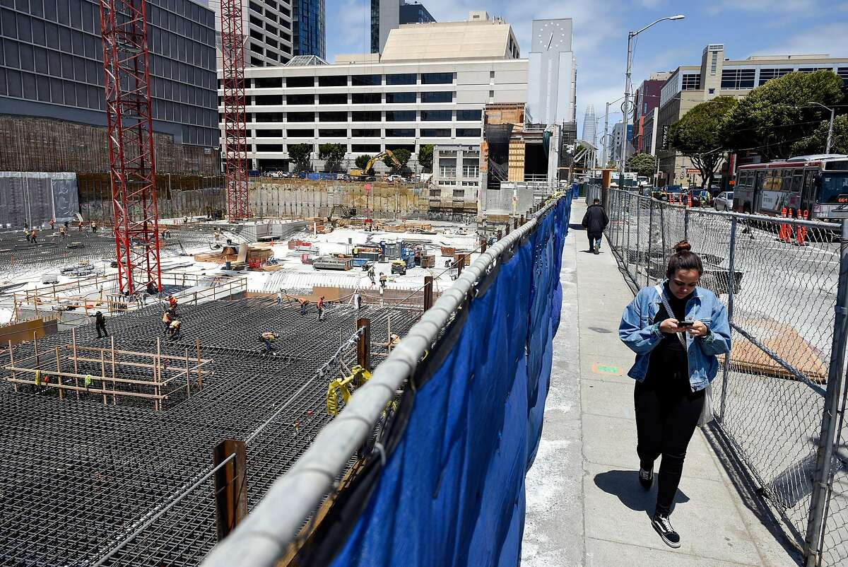 Pedestrians pass by ongoing work at a construction site on Mission and Van Ness Street in San Francisco, Calif., on Thursday May 31, 2018.
