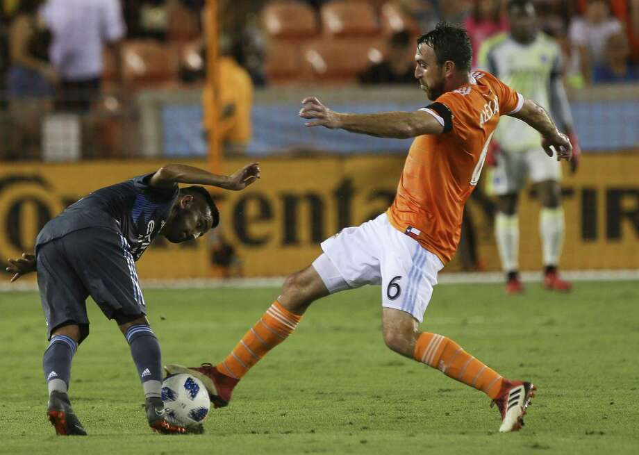 The Dynamo's Eric Alexander, right, battles New York City's Maximiliano Moralez in the club's most recent win May 25. Photo: Yi-Chin Lee / Houston Chronicle / © 2018 Houston Chronicle