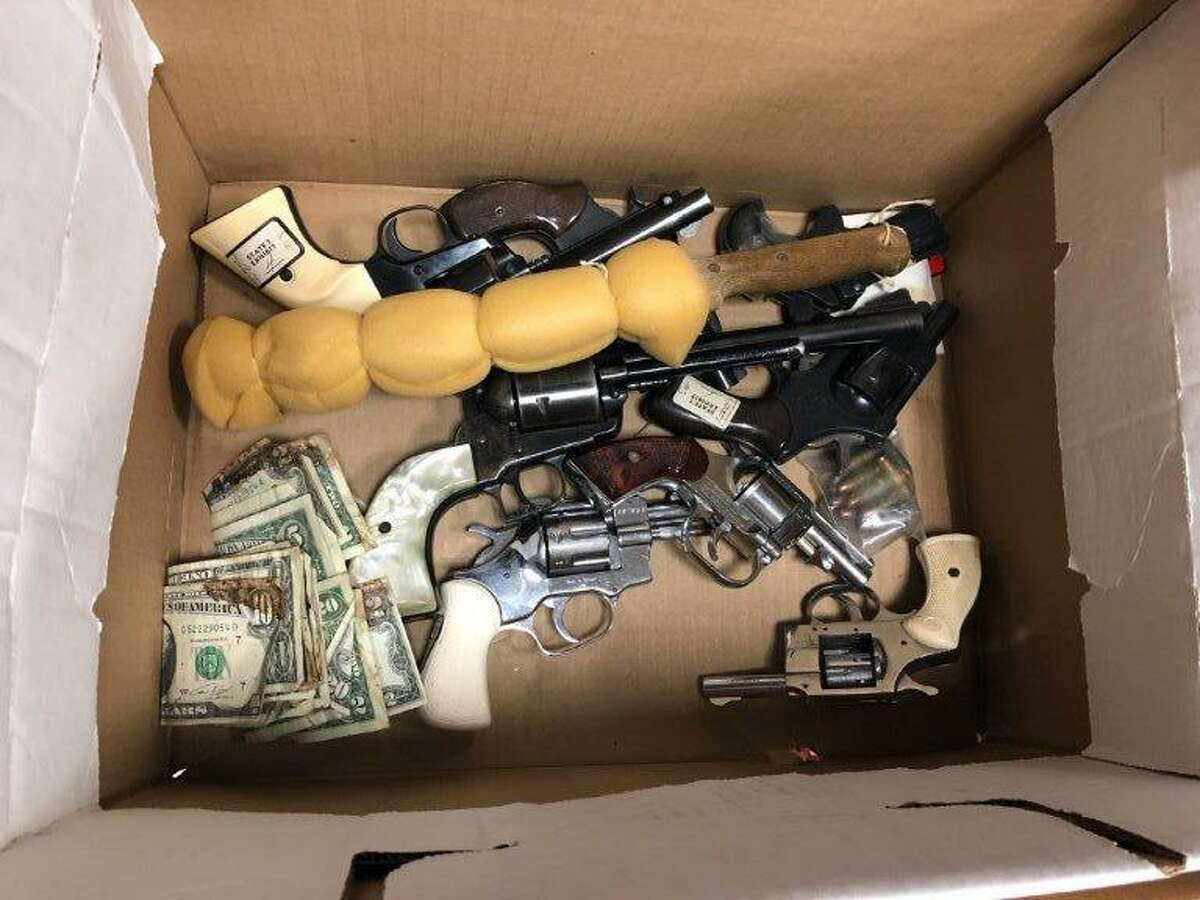 A box of guns, a steak knife and bloody money was found in the Harris County criminal courthouse in May 2018. It's not clear how they got there.