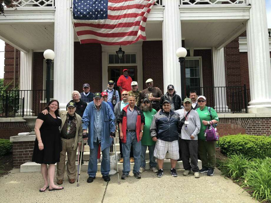 """Torrington Lodge of Elks, using money from the Elks National Foundation's Beacon Grant, were able to transport 20 veterans from Rocky Hill's Veterans Home to their lodge and the 2018 Memorial Day parade on Monday, May 28. The bus arrived at the lodge at 70 Litchfield St. at 9 a.m. Lodge members provided a breakfast before sending the group up to the reviewing stand under the Warner Theater marquee. After the parade, the Veterans met with Mayor Elinor Carbone, U.S. Sen. Richard Blumenthal and local dignitaries, and were introduced to the crowd at Coe Memorial Park during the memorial service. After a picnic style lunch and meeting with Cindy Szabo and officers of Torrington Lodge #372, the veterans returned to the Veterans Home by bus. Owen Quinn, Lodge Secretary told the veterans that he intended to use the same grant to invite veterans to come back for the Elks' Flag Day Ceremony June 14.. One veteran was heard to say that if the invitation goes on the home's activity board, """"You can count me in, that's for sure."""" Photo: Owen Quinn / Contributed Photo"""