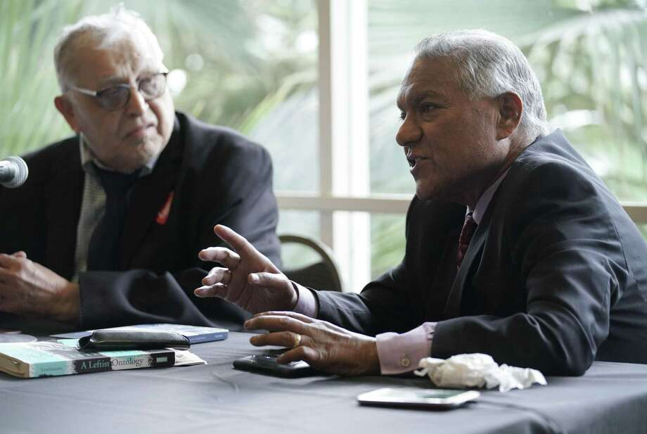 National LULAC legal adviser Luis Roberto Vera Jr. (right) speaks during a panel about Texas redistricting as Dr. Rodolfo Rosales looks on Friday, during the 89th LULAC State Convention in San Antonio. Photo: Darren Abate /For The San Antonio Express-News