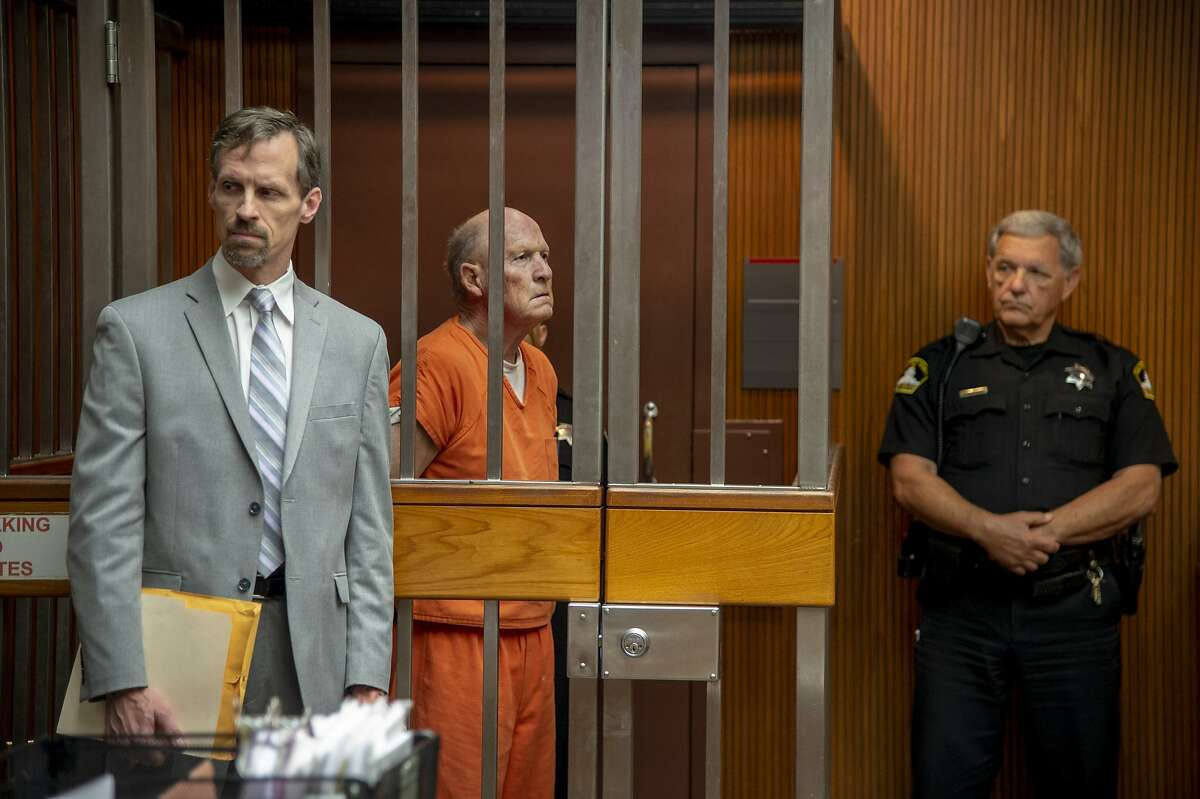 Defense attorney Joe Cress stands next to his client Joseph James DeAngelo appears in Sacramento Superior Court, Friday, June 1, 2018, in Sacramento, Calif. He is suspected in at least a dozen killings and roughly 50 rapes in the 1970s and '80s. (Jos� Luis Villegas/The Sacramento Bee via AP, Pool)