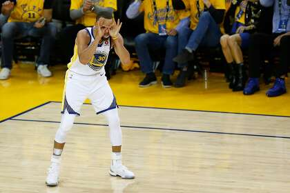 134effbea863 Stephen Curry  30 of the Golden State Warriors celebrates against the  Cleveland Cavaliers in overtime during Game 1 of the 2018 NBA Finals at  ORACLE Arena ...