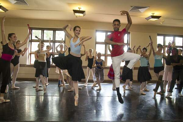 """Kate Maxted and Ihosvany Rodriguez surrounded by dancers at a """"Don Quixote"""" rehearsal for Ballet San Antonio, Saturday, Oct. 8, 2016."""