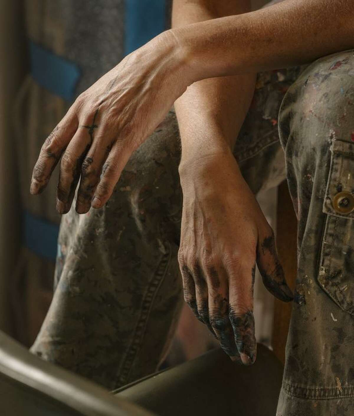 The hands of artist Cate White, an Oakland painter who is one of 25 artists selected.