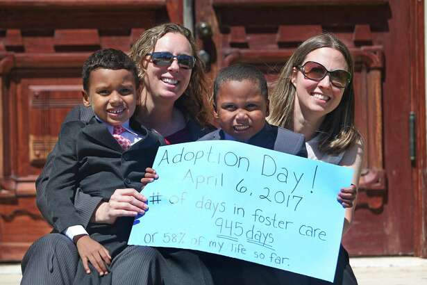 Angela Sugarek and Carol Jeffery celebrate the official adoption of their sons at the Wharton County courthouse, Thursday, April 6, 2017.