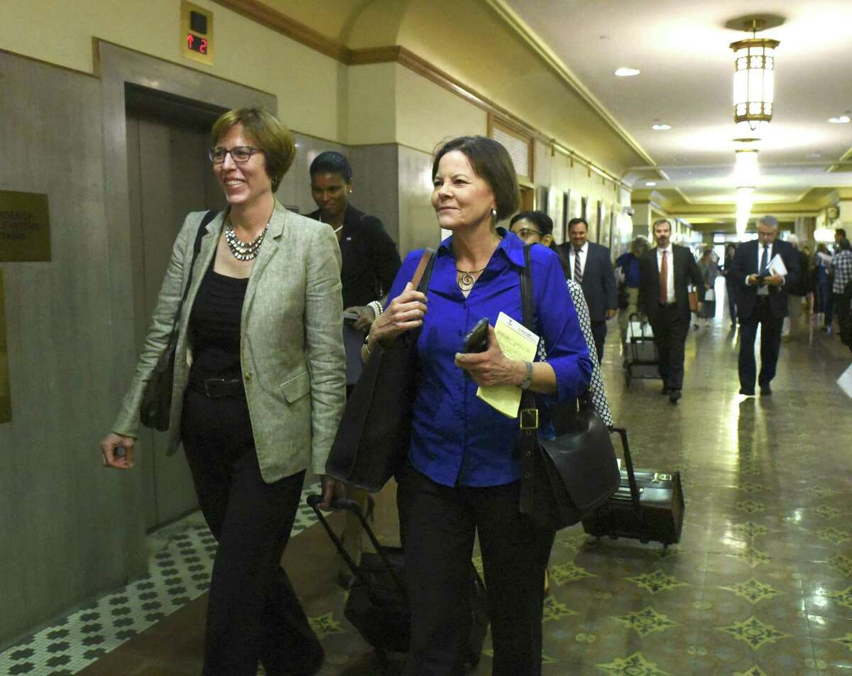 Shelley Potter, right, president of the SAISD teachers union, walks with attorney Martha Owen before a hearing at the Bexar County Courthouse last year during the union's attempt to block the charter network Democracy Prep Public Schools from taking over Stewart Elementary School. The district is considering an array of new partnerships to run up to 10 of its schools, but none of them would require teachers to give up their SAISD contracts, one of the reasons the Stewart agreement drew protests.