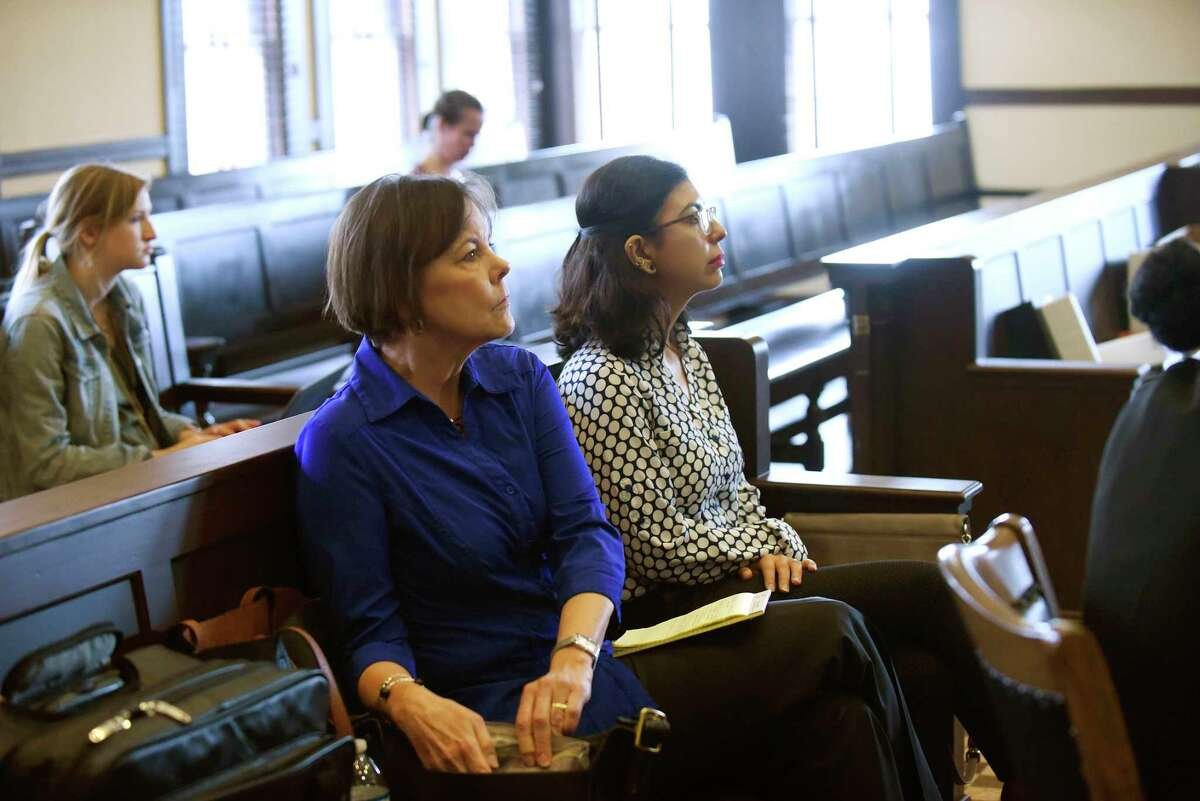 Shelley Potter, left, president of the SAISD teachers union, sits with Alejandra Lopez, second-grade teacher at Stewart Elementary School, during a hearing at the Bexar County Courthouse in 2018, in the union's unsuccessful attempt to get a court order to block Democracy Prep Public Schools from taking over Stewart.