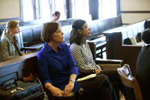 Shelley Potter, left, president of the SAISD teachers union, sits with Alejandra Lopez, second-grade teacher at Stewart Elementary School, during a hearing Friday at the Bexar County Courthouse on the union's request for a temporary injunction to block Democracy Prep Public Schools from taking over Stewart Elementary School. The union has sued the district to try to prevent its partnership with the New York-based charter network, which is set to start operating Stewart in August.