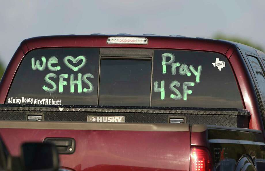 "A truck has paintings of ""We Love SFHS"" and ""Pray 4SF"" drive pass by the Santa Fe High School graduation ceremony on Friday, June 1, 2018, in Santa Fe. Photo: Yi-Chin Lee, Houston Chronicle / © 2018 Houston Chronicle"
