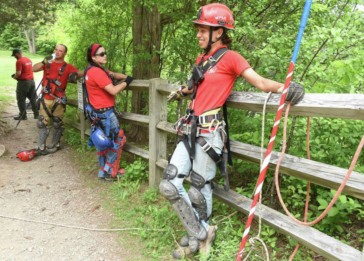 Members of New York State Parks Recreation & Historic Preservation scaling team take a break between rappelling down the rocky cliff above Indian Ladder Trail at John Boyd Thacher State Park on Thursday, May 31, 2018 in Voorheesville, N.Y. The scaling team, out of Ithaca, was poking loose rocks to make them fall to prevent future injuries to hikers. (Lori Van Buren/Times Union)