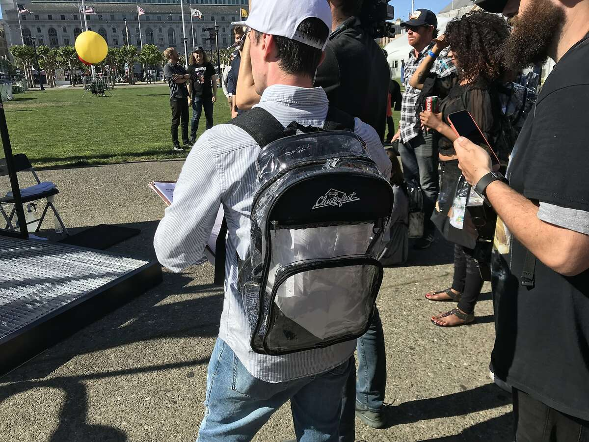 A festival-goer at Comedy Central Presents Clusterfest uses a new clear backpack on Friday, June 1, 2018.