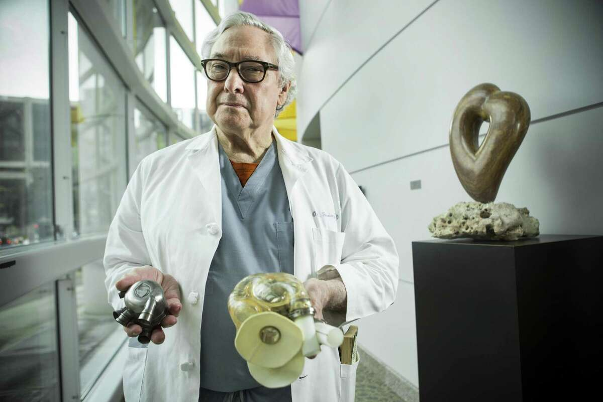 Dr. Bud Frazier poses for a portrait at the Texas Heart Institue on March 6, 2017 in Houston. Frazier holds a BiVACOR total Artificial Heart that is in development, on the left, and an AbioCor implantable replacement heart from 2001.