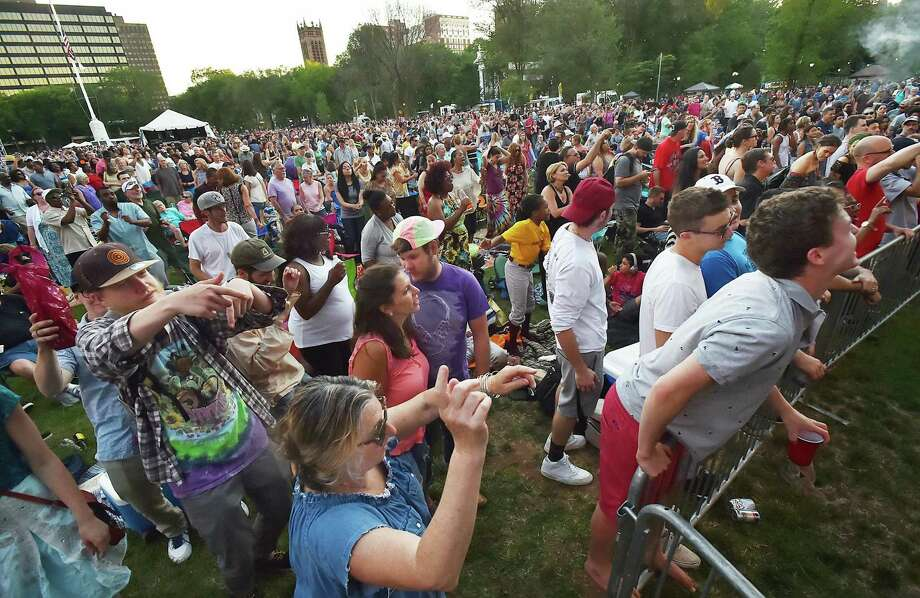 Thousands of concert-goers enjoy The Wailers on the New Haven Green in 2017. The first Green concert this year is June 9 at 6 p.m. Photo: Catherine Avalone / Catherine Avalone /New Haven Register / Catherine Avalone/New Haven Register