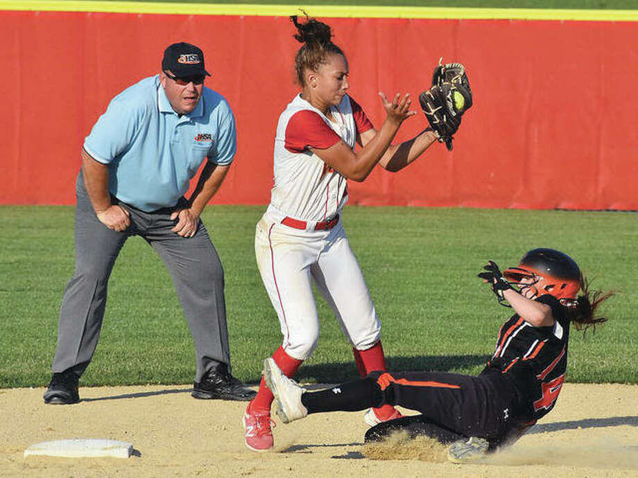 Edwardsville's Lauren Taplin slides under the tag of Rock Island infielder Lauryn Stegall in the ninth inning of Friday's Pekin 4A Sectional championship game. Photo:       Matthew Kamp | For The Telegraph