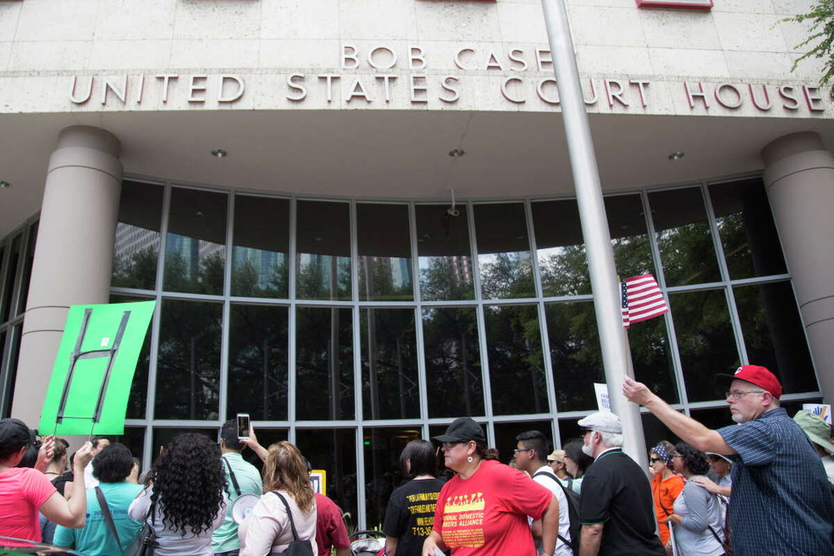 Protestors gather in front of the Bob Casey U.S Court House, Friday, June 1, 2018, in Houston. The activists were condemning the separation of families arrested at the border after crossing it illegally.