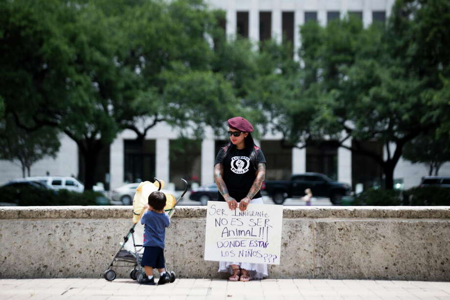 "Yesenia Hernandez holds a sign that says ""Being an immigrant isn't being an animal. Where are the children?,"" at the Rally for Children, Friday, June 1, 2018, at the Houston City Hall. Photo: Marie D. De Jesus, Houston Chronicle / © 2018 Houston Chronicle"