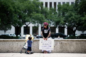 """Yesenia Hernandez holds a sign that says """"Being an immigrant isn't being an animal. Where are the children?,"""" at the Rally for Children, Friday, June 1, 2018, at the Houston City Hall."""