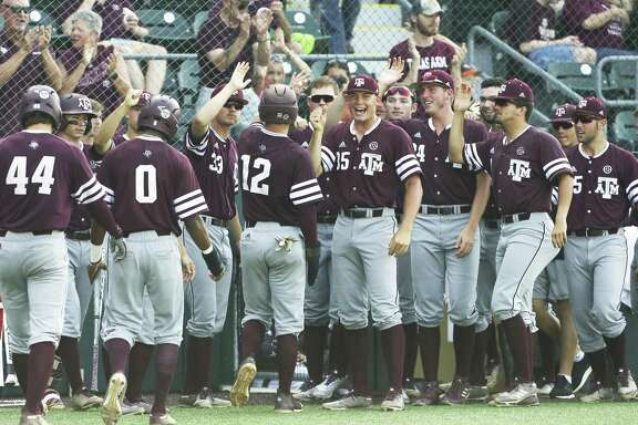 Texas A&M players celebrate during the fourth inning, where they scored seven runs.