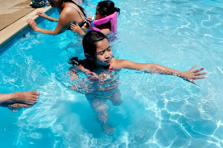 Madelyne Espina (7) cools off during the heat wave in the pool at Dorothy Heroy Park in Stamford, Conn. on Monday July 5, 2010. Photo: Dru Nadler / Stamford Advocate
