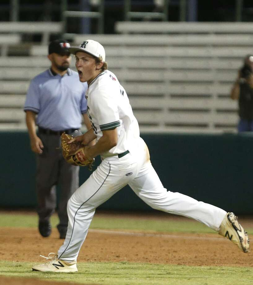 Reagan's Travis Sthele finished the game and begins to celebrate after the last out as Reagan plays Churchill at Wolff Stadium in game 2 of the Region IV-6A championship on Friday, June 1,2018. Photo: Ronald Cortes, For The San Antonio Express News / 2018 Ronald Cortes