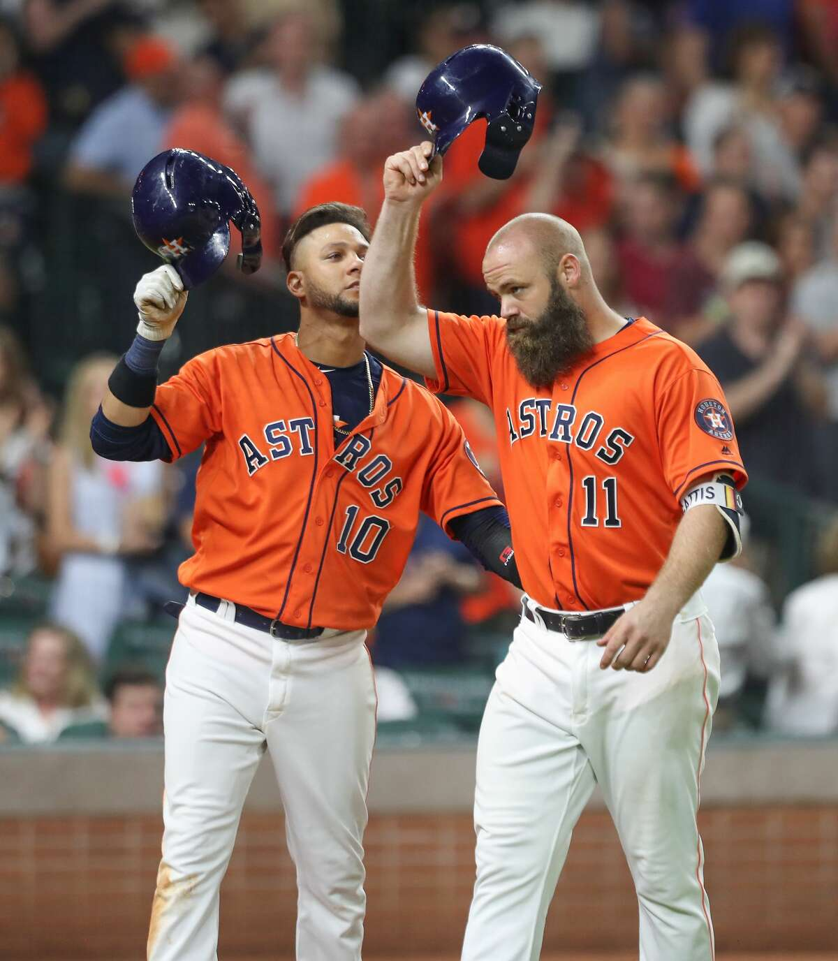 Houston Astros catcher Evan Gattis (11) tips his helmet to the crowd after scoring a two run homer during the 9th inning of an MLB baseball game at Minute Maid Park Friday, June 1, 2018, in Houston. Houston Astros first baseman Yuli Gurriel (10) was hit scored with Gattis' hit. ( Steve Gonzales / Houston Chronicle )