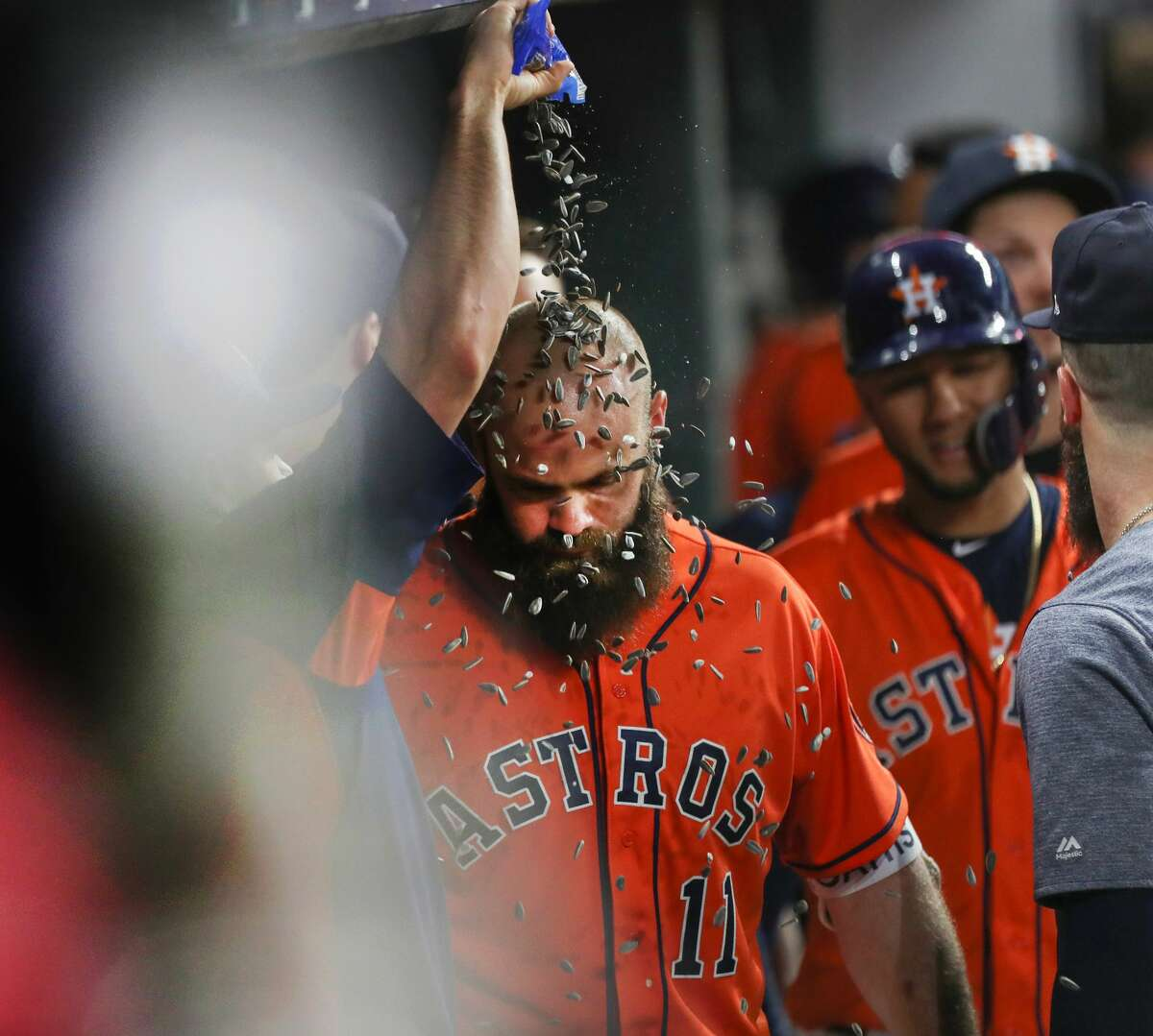 Houston Astros catcher Evan Gattis (11) receives a sunflower seed shower after scoring a two-run homer during the 9th inning of an MLB baseball game at Minute Maid Park Friday, June 1, 2018, in Houston. Houston Astros first baseman ( Steve Gonzales / Houston Chronicle )