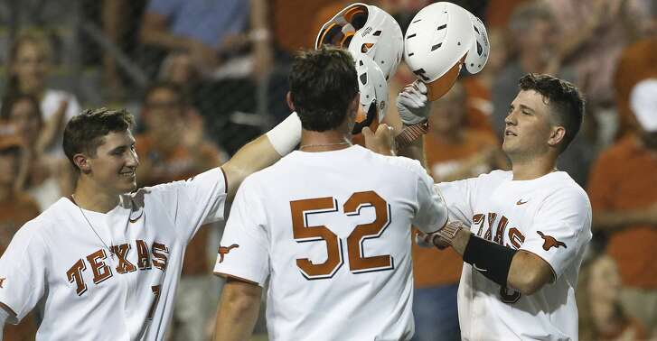 Longhorn catcher DJ Petrinsky (right) is congratulated at home plate by teammates Masen Hibbeler (7) and Zach Zubia after a power shot homer in the fourth as Texas  plays Texas Southern University at Disch-Falk Field in Austin in the first round of the NCAA Regional playoffs on June 1, 2018.