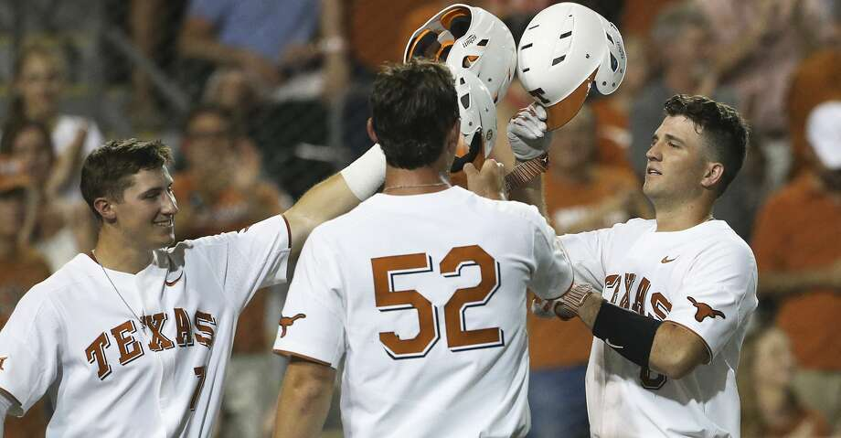 Longhorn catcher DJ Petrinsky (right) is congratulated at home plate by teammates Masen Hibbeler (7) and Zach Zubia after a power shot homer in the fourth as Texas  plays Texas Southern University at Disch-Falk Field in Austin in the first round of the NCAA Regional playoffs on June 1, 2018. Photo: Tom Reel/San Antonio Express-News