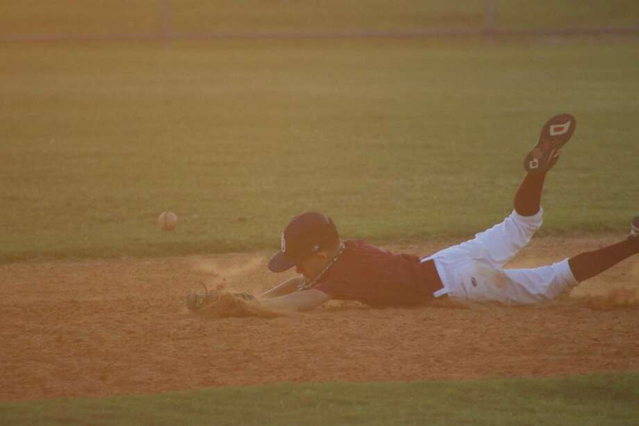 Cameron Collier makes a diving effort to stop a ground ball Thursday night, but it still found the outfield grass. Photo: Robert Avery