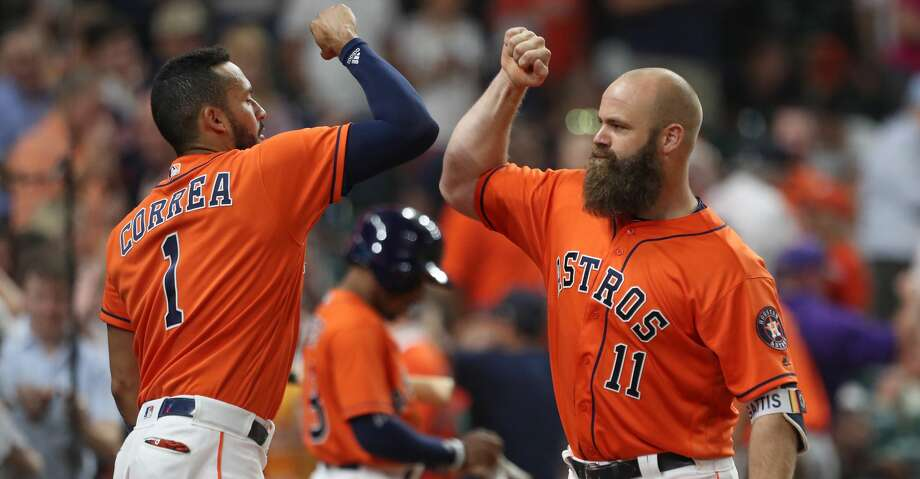 Houston Astros catcher Evan Gattis (11) celebrates after scoring a twtih Houston Astros shortstop Carlos Correa (1) after scoring a two-run homer during the 9th inning of an MLB baseball game at Minute Maid Park Friday, June 1, 2018, in Houston. Houston Astros first baseman ( Steve Gonzales / Houston Chronicle ) Photo: Steve Gonzales/Houston Chronicle