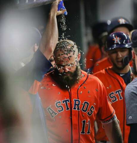 Houston Astros catcher Evan Gattis (11) receives a sunflower seed  shower after scoring a two-run homer during the 9th inning of an MLB baseball game at Minute Maid Park Friday, June 1, 2018, in Houston. Houston Astros first baseman ( Steve Gonzales / Houston Chronicle ) Photo: Steve Gonzales/Houston Chronicle