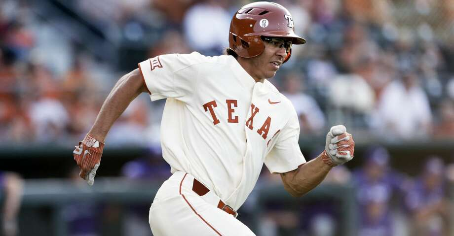 Longhorn lead off hitter David Hamilton rounds first base on an early inning s double as UT hosts TCU in men's baseball at Disch-Falk Field on May 18, 2018. Photo: Tom Reel/San Antonio Express-News