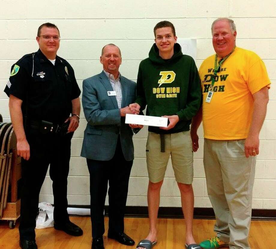 Project 111 Award was presented to Dow High School Senior Josh Seidel, who chose an Apple watch as his award. Shown left to right are Midland Police Department Community Relations Sargent Chris Wentzel, Scott Withrow of Saginaw Bay Underwriters, Josh Seidel and Dow High School Principal Steve Poole.
