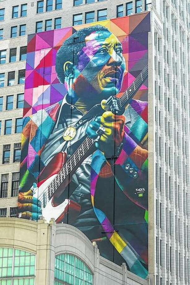 A nine-story mural of blues music legend Muddy Waters by artist Eduardo Kobra was completed in 2017 on State Street in Chicago. Photo:       Ashlee Rezin | Sun-Times