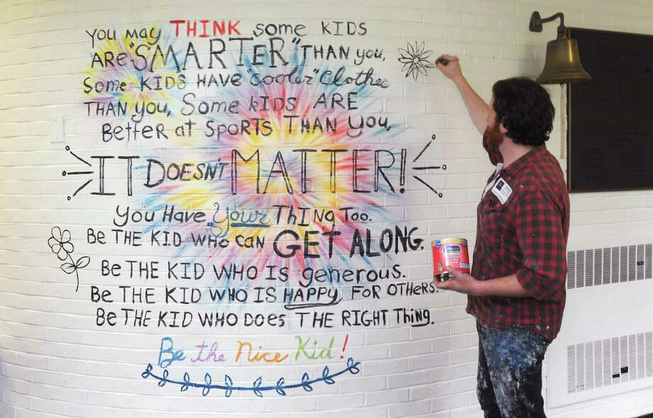Alex Churchill from Floe Painting to paint inspirational sayings at Cranbury Elementary School Friday, June 1, 2018,  in Norwalk, Conn. The project is intended to brighten the hallways and have the kids exposed to the messages daily. Photo: Erik Trautmann / Hearst Connecticut Media / Norwalk Hour