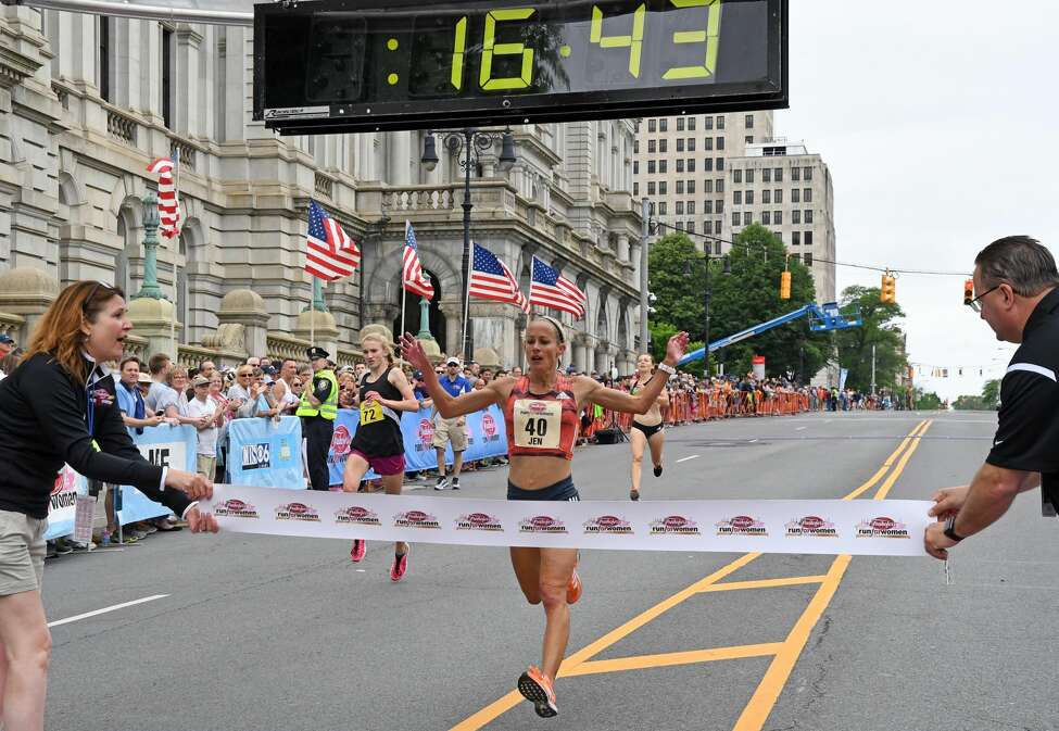 Jen Rhines finishes first in the masters division at the Freihofer's Run for Women in Albany on Saturday, June 2, 2018.